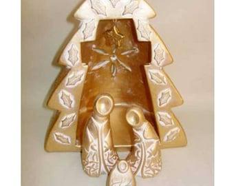 Golden cross Christmas crib