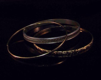 Set of Three Gold and Silver Bangle Bracelets