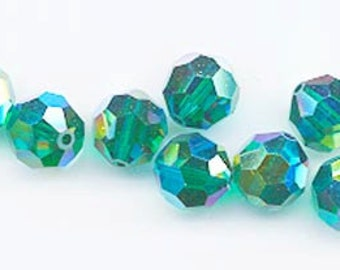 Eleven dazzling limited edition Swarovski crystals: art 5000 - 8 mm - emerald AB 2X