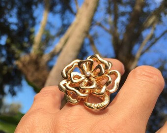 Sterling Silver , Gold - Plated , or 14K solid. Unique Flower Ring with spinning kinetic movement  of each layer w/cubic zirconia stone.