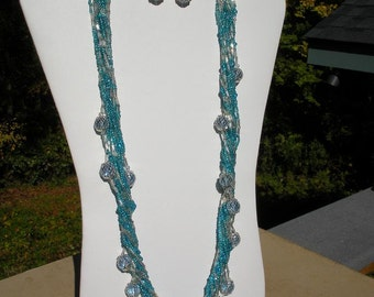 Blue multistrand seed bead necklace with accent beads.