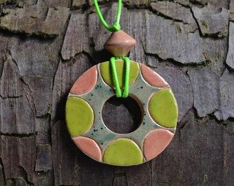 Ceramic patterned and glazed pendant: green and orange