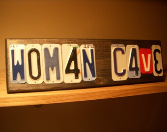Woman Cave sign made with recycled license plates.