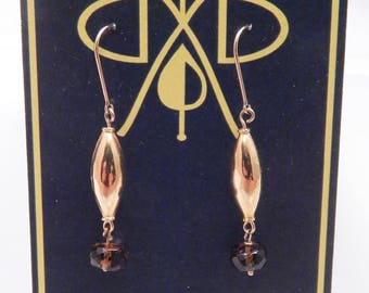 gorgeous gold dangle earrings with tourmaline beads