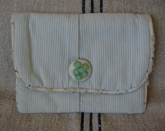 Travel Clutch made from repurposed Jeans for Journal or Jewelry with hand Embroidered Button