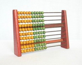 Vintage wooden school abacus. Wooden Calculator. Old wooden toy.