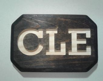 CLE plaque