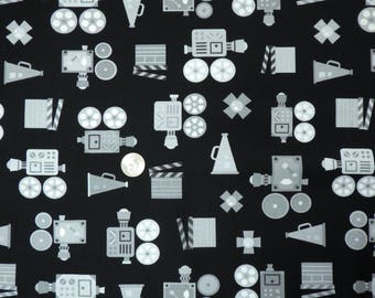 Robert Kaufman - Let Me Entertain You - 16334 Black - Gray and White Movie Cameras on Black - One Yard of Fabric