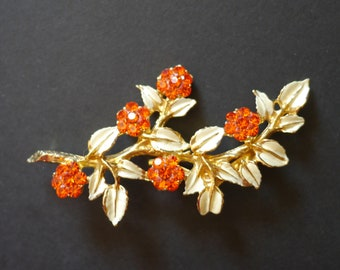 Large enamel brooch, painted white leaves and bright orange sparkly rhinestone flowers