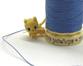 1/2 inch micro miniature crocheted kitten made from thread