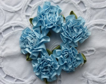 Pale blue satin carnation flowers.   Approximately  25mm across.  Set of 12