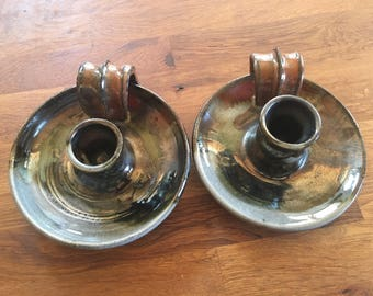 Set of two candle holders with loop handles handmade on the potters wheel by Ruth Sachs in New York