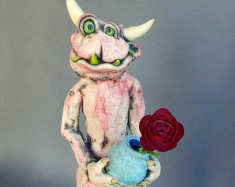 Lovable Monster with Rose Ceramic Sculpture