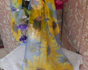 Hand painted sunflowers with a light blue sky background on sheer pure chiffon silk .