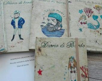 Block notes with elastic-logbook mermaids