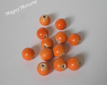 Set of 12 orange wood round beads