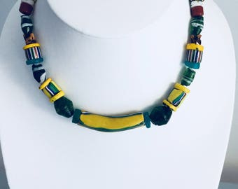 yellow and green necklace with a big millefiori bead.