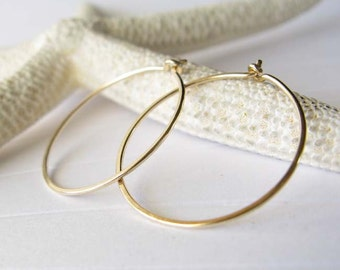 "Solid 14k gold thin hoop earrings. Small 7/8"" size endless hoops. Modern simple gift for women. 14k Yellow or Palladium White Gold."