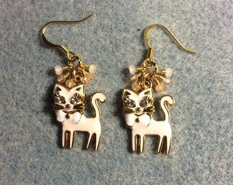 Pink cat earrings: Light pink enamel and rhinestone cat charm earrings adorned with tiny dangling peach and pink Chinese crystal beads.