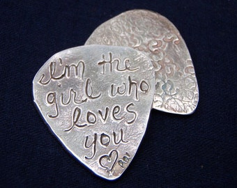 recycled silver guitar pick . custom guitar pick . personalized with im the girl who loves you inscription. free shipping by peacesofindigo
