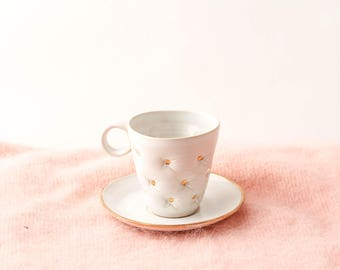 White ceramic espresso cup, handmade and decorated with pillow effect and golden dots/ small cup and saucer/ white and gold/ wheel thrown