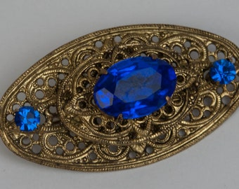 1950s 1960s Retro Art Nouveau Gold Tone Filigree & Sapphire Blue Faceted Glass Rhinestone Mid Century Vintage Oval Pin Brooch