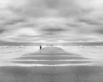 Printed and Framed photo - symmetrical illusion of a man standing at the beach in black and white
