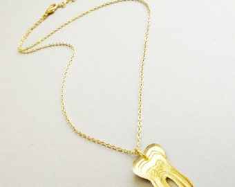 Gold Tooth laser cut acrylic pendant