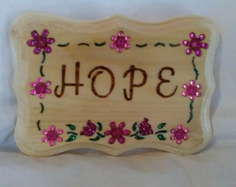 Hope wood burned plaque with inspirational message, decorated with pink and purple flowers and green vines embellished with colored crystals