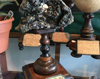 Augite on wooden base