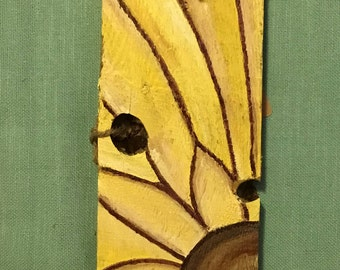 Hand painted sunflower on recycled wood.