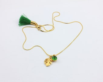Monstera Leaf Necklace with Fern Green Swarovski Crystal Pendant Charm and Handmade Tassel by Detail London.
