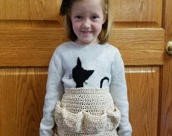 Childs egg gathering apron.