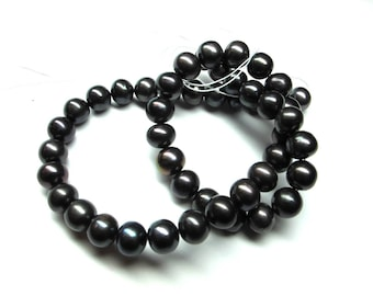 7 SEMI-PRECIOUS 8 MM TAHITIAN BLACK BAROQUE PEARLS