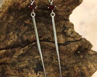 Silver spike earrings with round faceted garnet in silver prongs setting and sterling silver post style