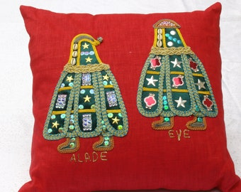 Decorative linen pillow features embroidery