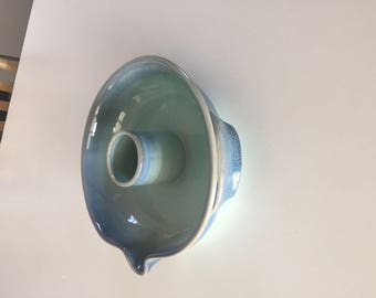 Art pottery blue bowl with spout two handles and center piece