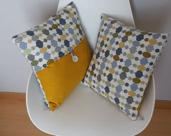 The patterned pillow cover geometric yellow mustard, blue, grey and light brown on light grey background