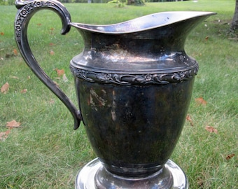 Silver-plated water pitcher by Rogers footed ornate