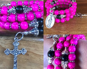 Handmade 5 decade rosary wrap bracelet in pink and black 6mm turquoise beads. Memory wire cuff bracelet with five decades, crucifix & charm