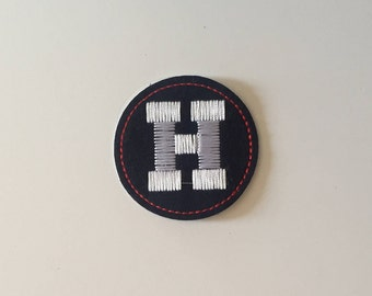 H  Iron on patch