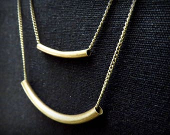 Graphic necklace tube curved brass two tiered