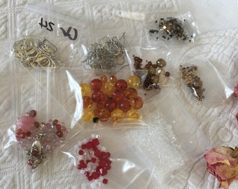 Craft Beads and Findings. Pictures Show the Contents. Earring Wires & Loops, Some Swarovski Crystals. Some Seed Beads and Glass Beads.