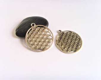 Aged silver charm flower of life pendants.