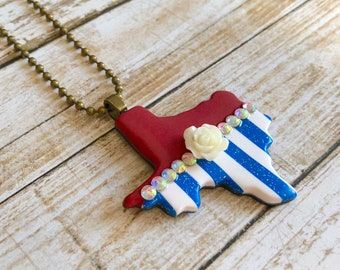 Texas Jewelry, Red with Blue striped Texas shaped Pendant Necklace-flower and rhinestone embellishments, polymer clay