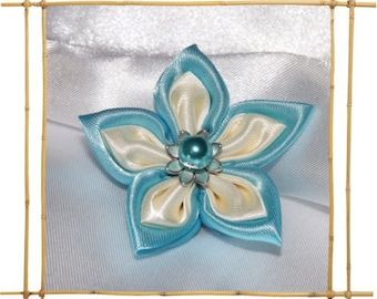 kansashi flower turquoise and ivory satin lining