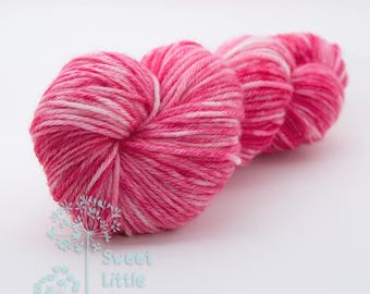 Beautiful hand dyed pink hank of DK weight superwash merino wool