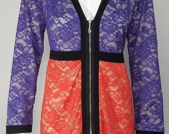 Women's lace color block dress with sleeves.