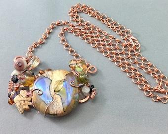 bead soup pendant, bold jewelry, iridescent beaded pendant, copper jewelry, oilslick, wire wrap lampwork, hammered copper, gemstone bird