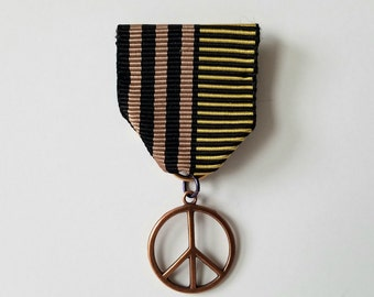 Moonflower Peace Medal (Black, taupe, gold striped ribbon, peace sign)
